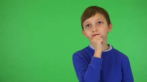 Thumbnail for A Young Cute Boy Thinks About Something - Green Screen Studio