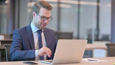 Businessman Talking on Video Call on Laptop