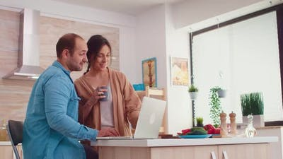 Couple Smiling at Laptop Screen