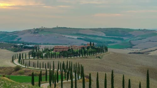 Sunset time lapse of Tuscany landscape in Italy