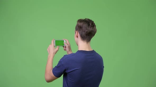 Thumbnail for Young Handsome Teenage Boy Photographing with Phone