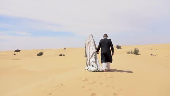 Thumbnail for Newlyweds Walking in the Desert