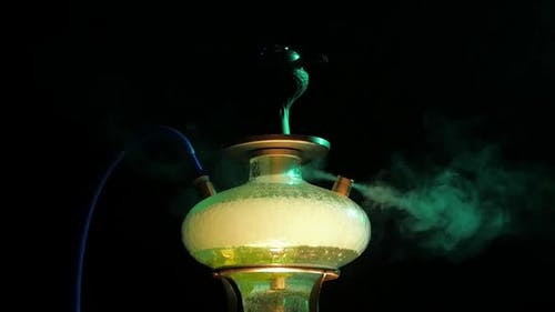 One Colored Yellow Hookah with the Smoke, Close Up. Slow Motion