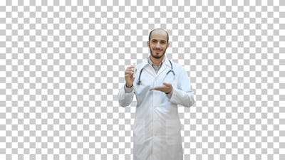 Smiling doctor in uniform pointing at, Alpha Channel