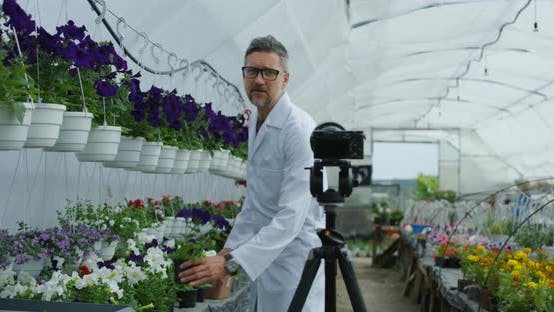 Thumbnail for Male Gardener Presenting Plant To Camera