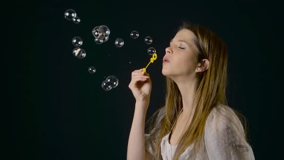 Thumbnail for Pretty Woman Blowing Bubbles Slow Motion