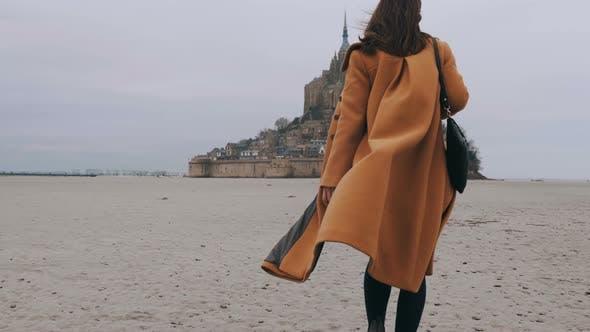Medium Rear View Shot, Elegant Happy Blogger Woman Walks on Sea Bottom Sand at Epic Mont Saint
