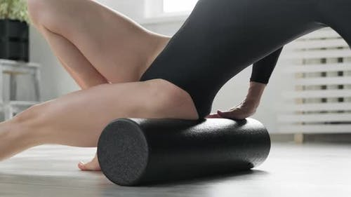 Female in Black Bodysuit with Slim Body Training Indoors
