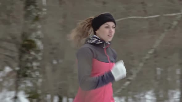 Thumbnail for Woman Athlete Through Forest in Cold Weather