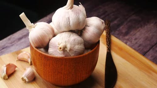 Close Up Pf Garlic in a Container on Table