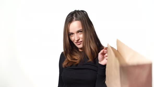 Cover Image for Brunette With Shopping Bags