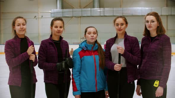 Thumbnail for Curling Training - the Judge Standing on the Ice Rink with Her Women Students