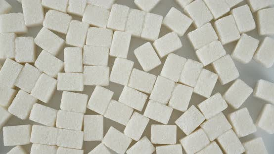 Lots of Sugar Cubes Rotates on the Table