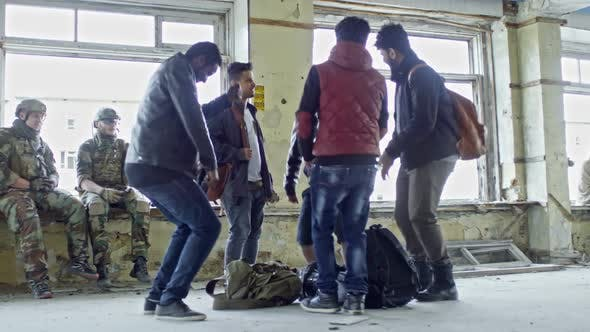 Thumbnail for Happy Refugees Dancing in Abandoned Building