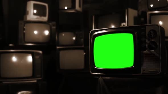 Old TV with Green Screen and a Vintage TV Wall. Sepia Tone.