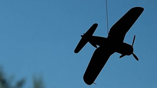 Thumbnail for Small Airplane Rotates On A String 3