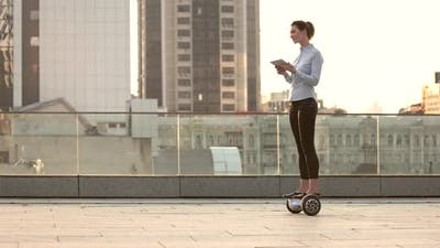 Woman on Hoverboard, Urban Background