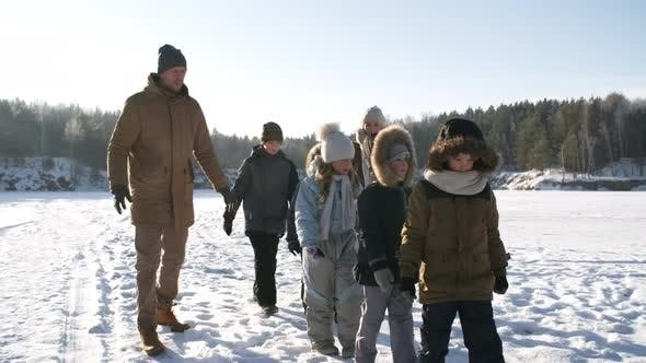 Thumbnail for Active Large Family Walking Over Ice