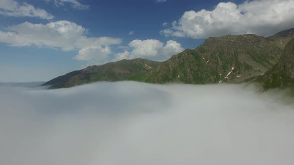 Thumbnail for Rising Above The Clouds in Wide Valley