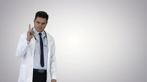 Thumbnail for Doctor Man, Medical Professional Making a Point Gesture and Presenting Something on the Background
