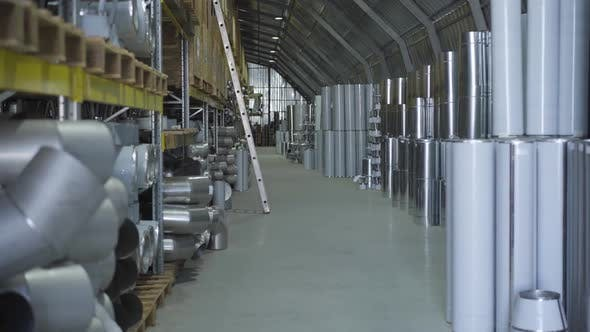 Warehouse with Metal Ready Production. Steel Metal Pipes Stored in Freight Terminal. Steel Industry