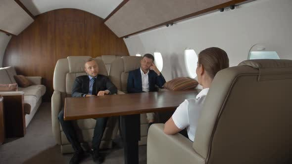 Thumbnail for Premium View of Businesspeople Have Meeting in Corporate Aircraft