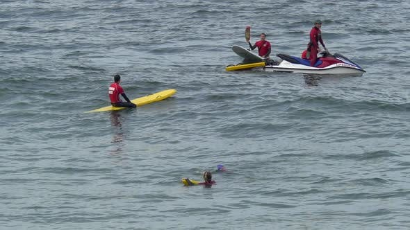 A group of lifeguards and their paddleboards.