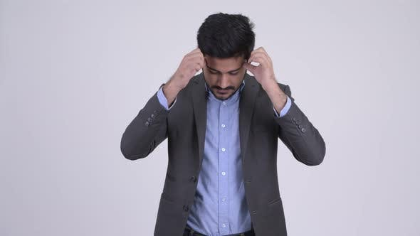 Thumbnail for Young Stressed Bearded Indian Businessman Having Headache