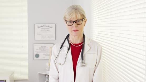 Thumbnail for Serious senior woman doctor looking at camera