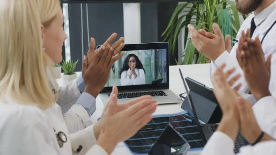 Experienced Diverse Medics Watching Online Conference and Greeting Each Other with Applauses