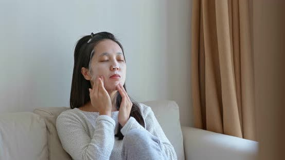 Thumbnail for Woman Apply Face Mask