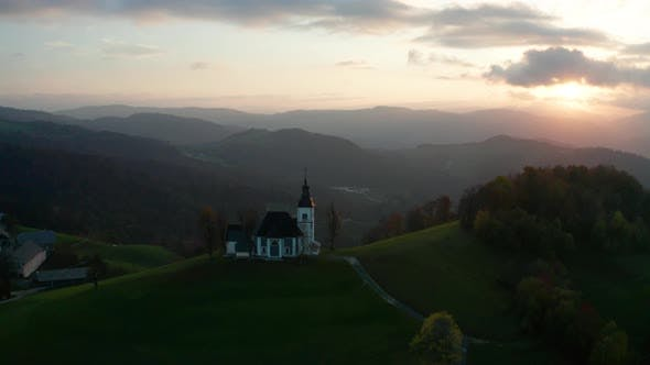 Thumbnail for Amazing Beautiful Aerial View of the Hills, Colorful Forest and the Sv Sobota Church. Slovenia