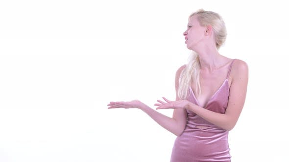 Thumbnail for Stressed Young Blonde Woman Showing Something