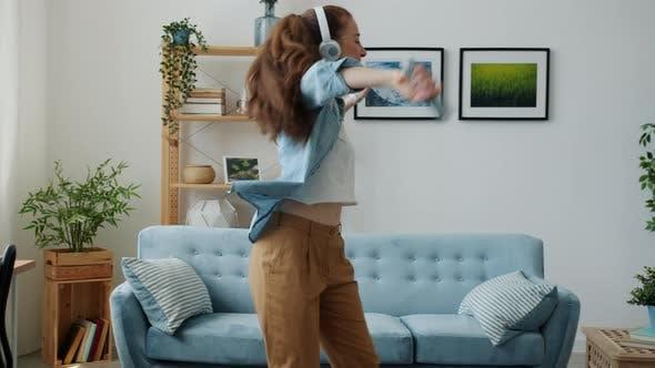 Happy Girl Dancing Having Fun Singing in Remote Control Entertaining at Home