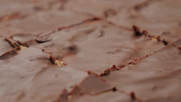 Thumbnail for Glazed chocolate cake divided on smaller pieces 4K 2160p UltraHD footage - Slow tilting over glazed