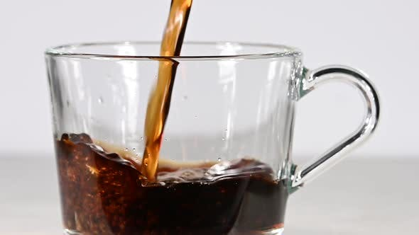 Thumbnail for Pouring Black Coffee Into Glass Cup Over White