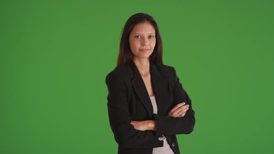Thumbnail for Happy business woman with arms crossed looking at camera on green screen