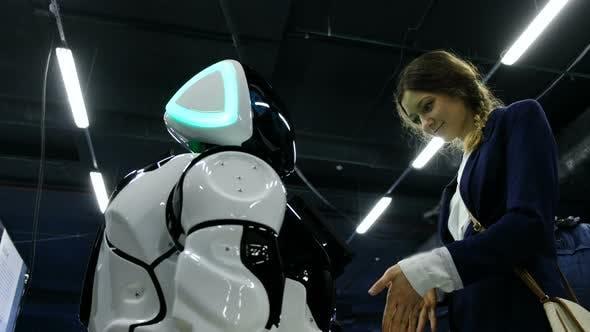 Girl Reads a Promo-robot Screen
