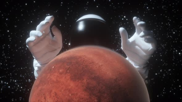Thumbnail for An Astronaut Stretches His Hands Behind the Planet Mars