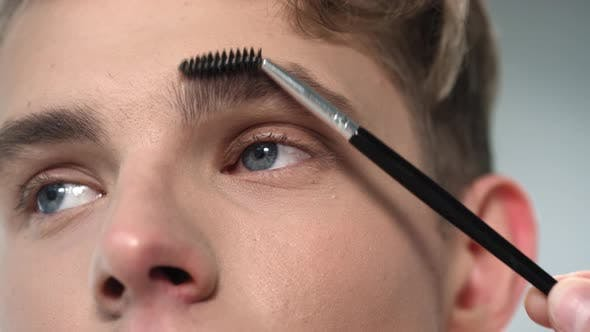 Man Getting His Eyebrows Brushed