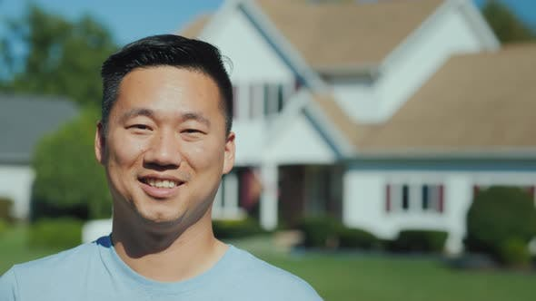 Thumbnail for Portrait of a Young Successful Asian Man Against the Background of a New Home