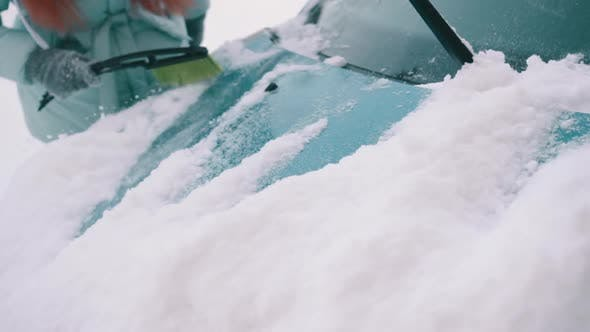 Thumbnail for Woman Removes Snow From Her Car
