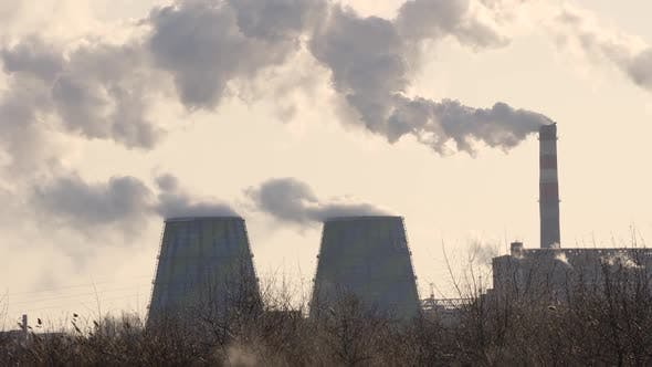 Power Plant Pipes Emit Harmful Dark Smoke Into the Atmosphere