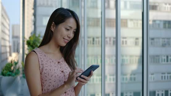 Cover Image for Woman use mobile phone