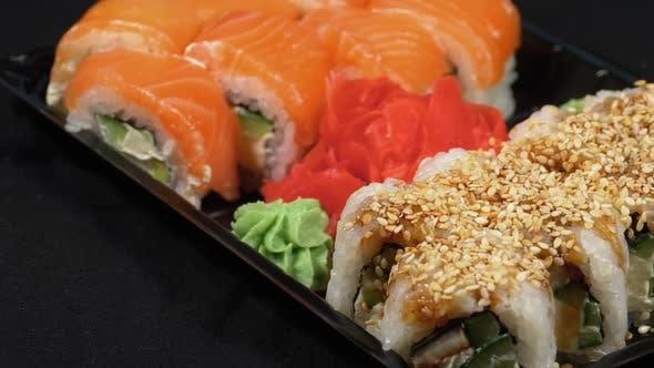 Thumbnail for Sushi Rotates on Plastic Box. Japanese Sushi Roll Set Philadelphia, California