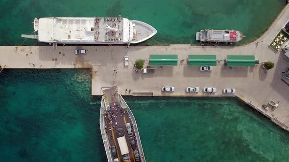 Aerial view of ferry docking on pier at Nisi, Greece.