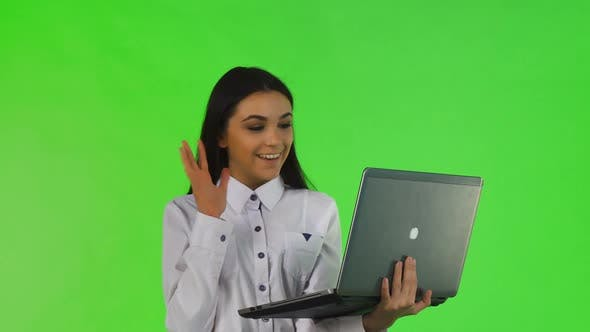 Thumbnail for Beautiful Businesswoman Video Chatting on Her Laptop