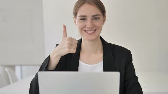 Thumbnail for Thumbs Up by Young Businesswoman at Work