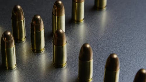 Cinematic rotating shot of bullets on a metallic surface - BULLETS 038