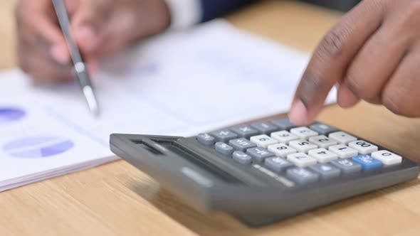 Thumbnail for African Businessman Using Calculator for Financial Work